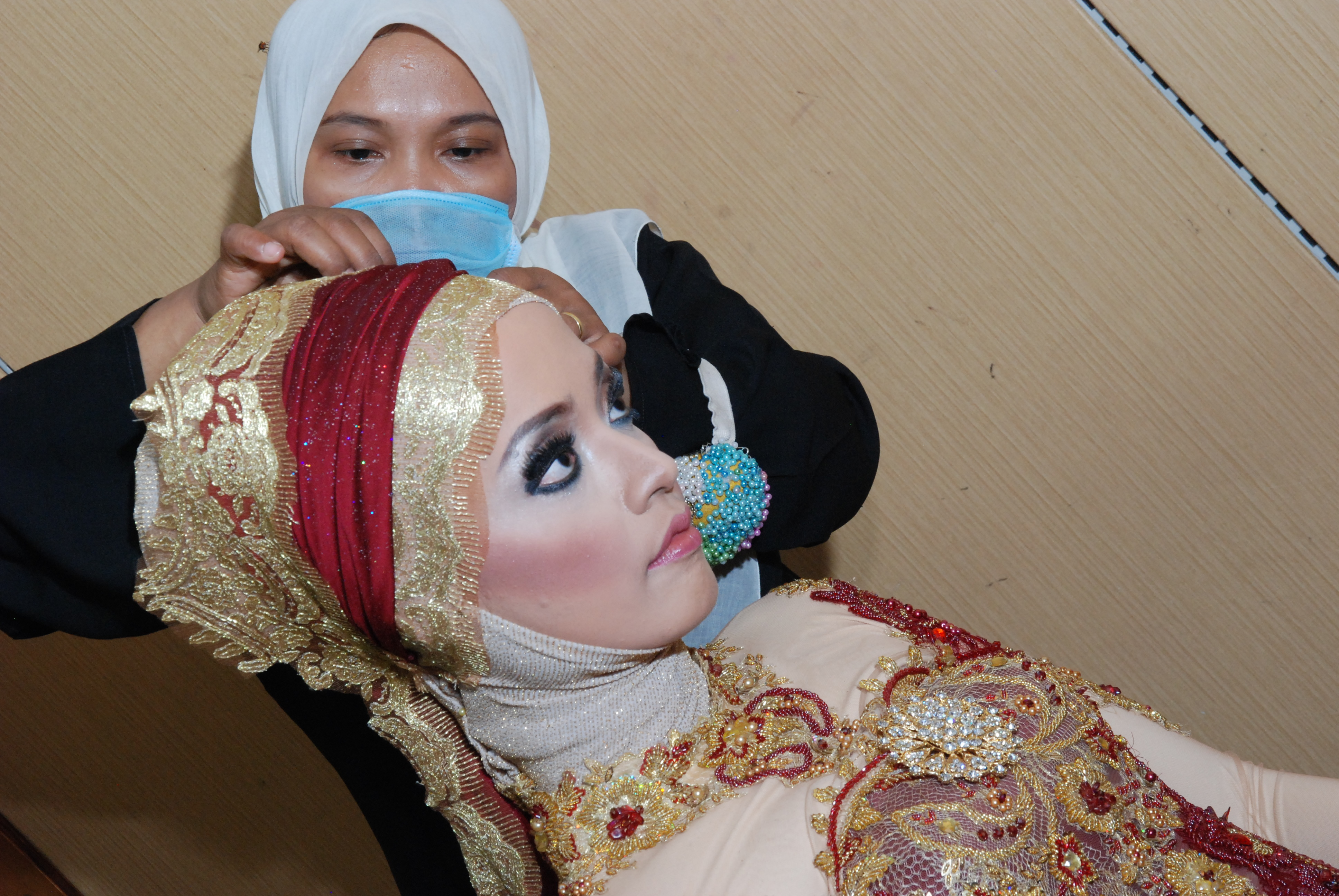 the expert is working on my hijab